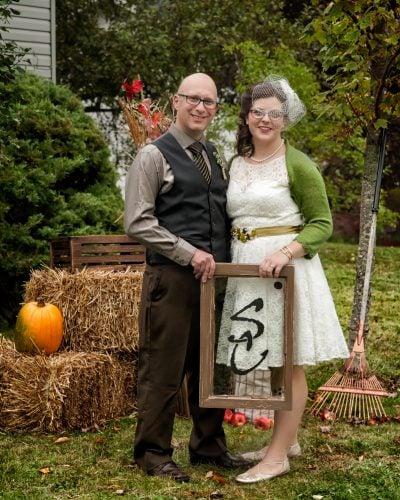 The bride and groom during their autumn backyard wedding posing for wedding photos in Dartmouth Nova Scotia.
