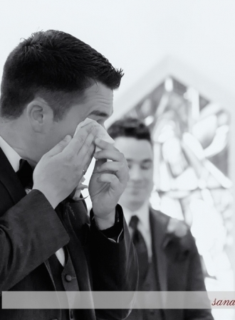 A groom cries when he sees his bride walk up the aisle at the St Brendans Parish, Juno Tower.