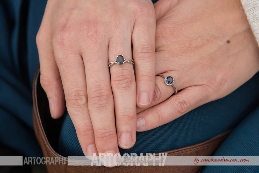 Lesbian couple's matching sapphire engagement rings.