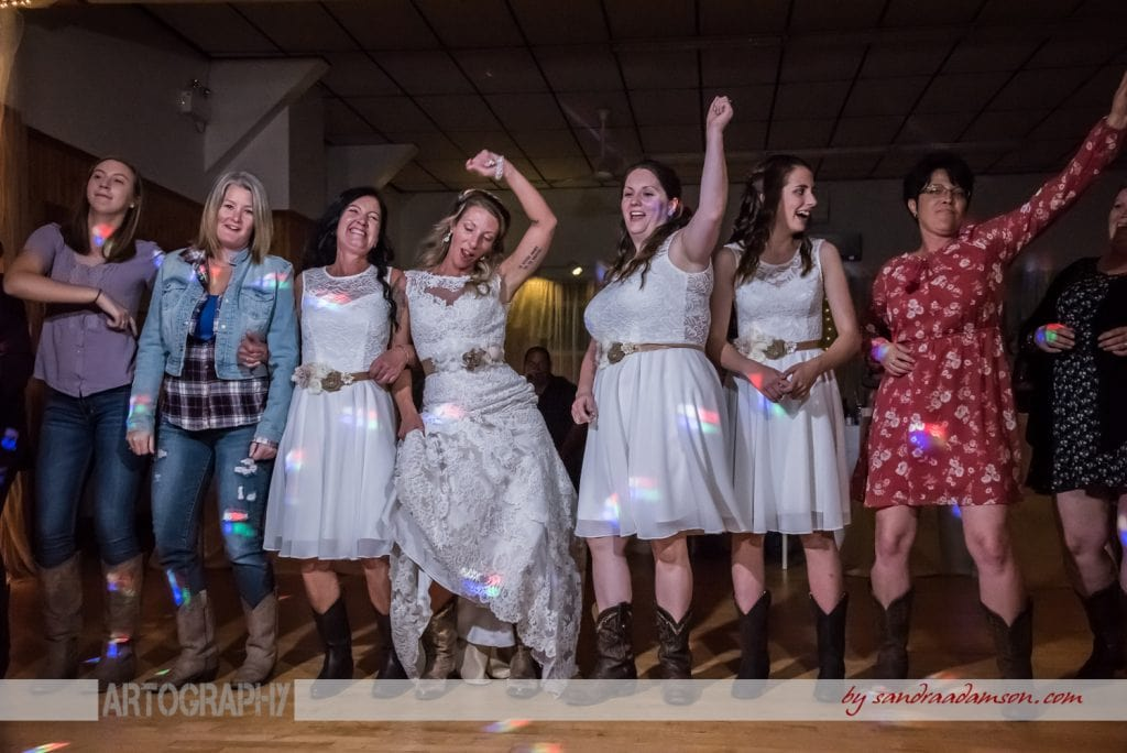 halifax ns wedding photographer, halifax wedding photographers, halifax engagement photographer, engaged, sandra adamson studios, lower harmony, truro, nova scotia, salmon river firehall, salmon river ns, wedding reception, dancing, cowboy boots, bride, bridesmaids, guests