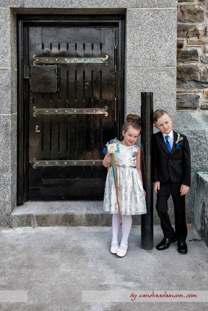 A flower girl and ring bearer pose for wedding photos at a same sex wedding in Halifax NS.