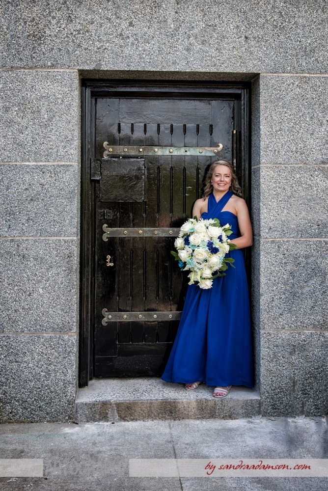 A lesbian bride poses for her gay wedding photos at the Dingle Tower in Halifax, NS.