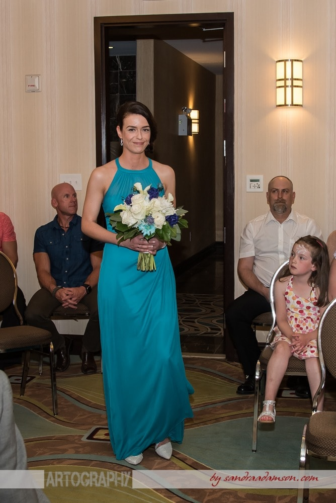 A lesbian bride walks up the aisle during her same sex gay wedding ceremony  at the Comfort Hotel Bayers Lake in Halifax, NS.