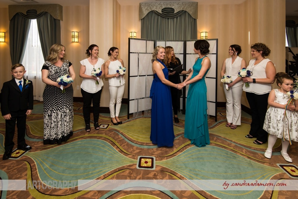 A lesbian gay wedding couple say their vows during their same sex wedding ceremony at the Comfort Hotel Bayers Lake in Halifax, NS.
