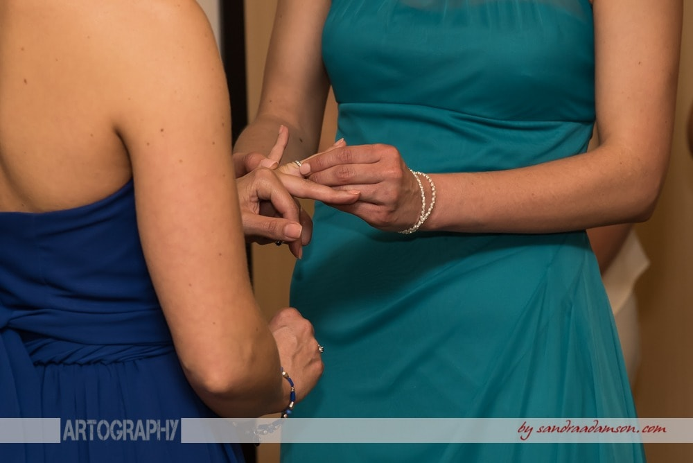 A lesbian gay wedding couple exchanges wedding rings during their same sex wedding ceremony at the Comfort Hotel Bayers Lake in Halifax, NS.