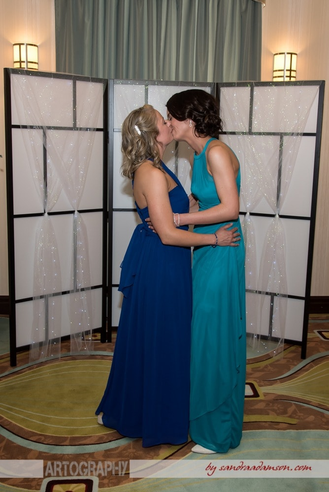 Lesbian brides have their first kiss during their gay wedding at the Comfort Hotel Bayers Lake in Halifax, NS.
