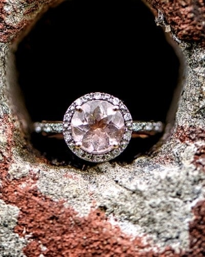 A beautiful pink diamond engagement ring captured in an urban setting at Point Pleasant Park in Halifax.