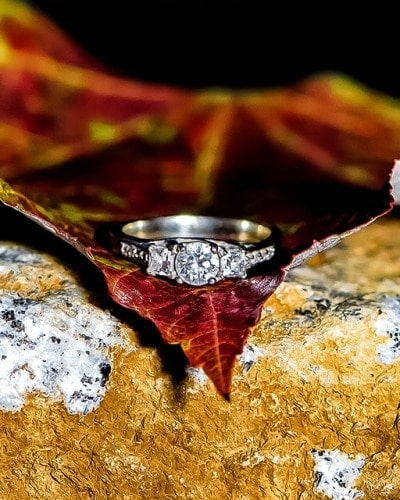 The engagement ring laying on an autumn leaf during an engagement shoot at Point Pleasant Park in Halifax, NS.