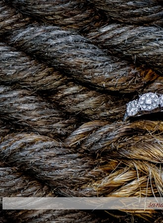 Halifax wedding photographer captures an engagement ring during an engagement shoot at the Historic Properties in Halifax, NS.