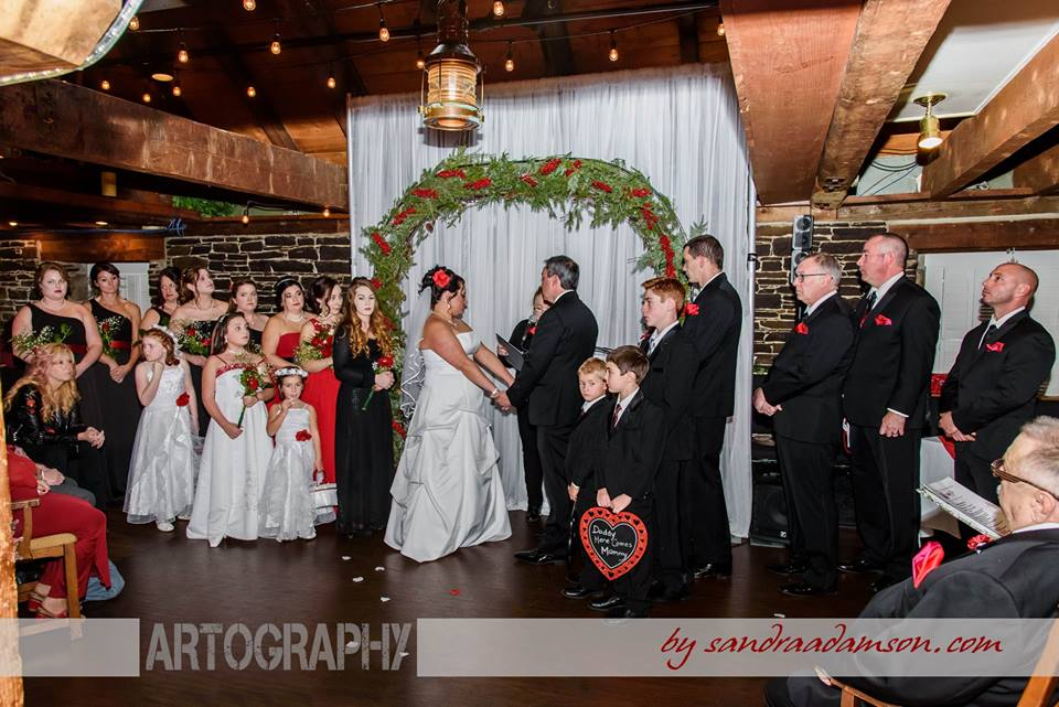 The bride and groom during their wedding ceremony at the Lower Deck Tap Room in Halifax.