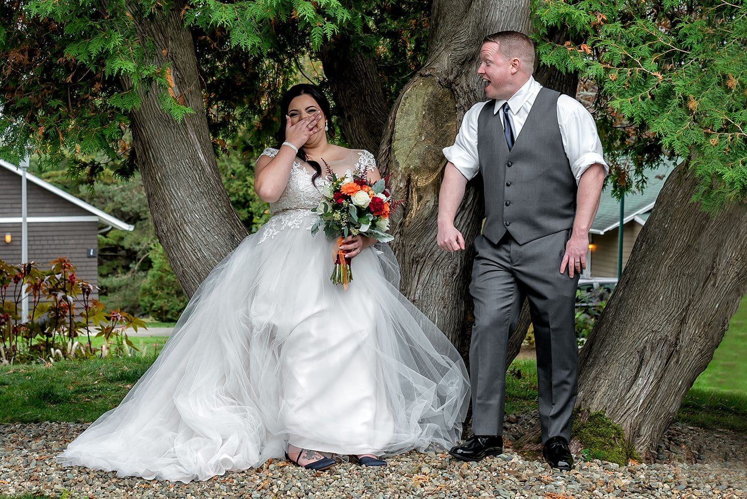 fun candid bride and groom photos taken by a tree during a wedding at the Digby Pines Resort