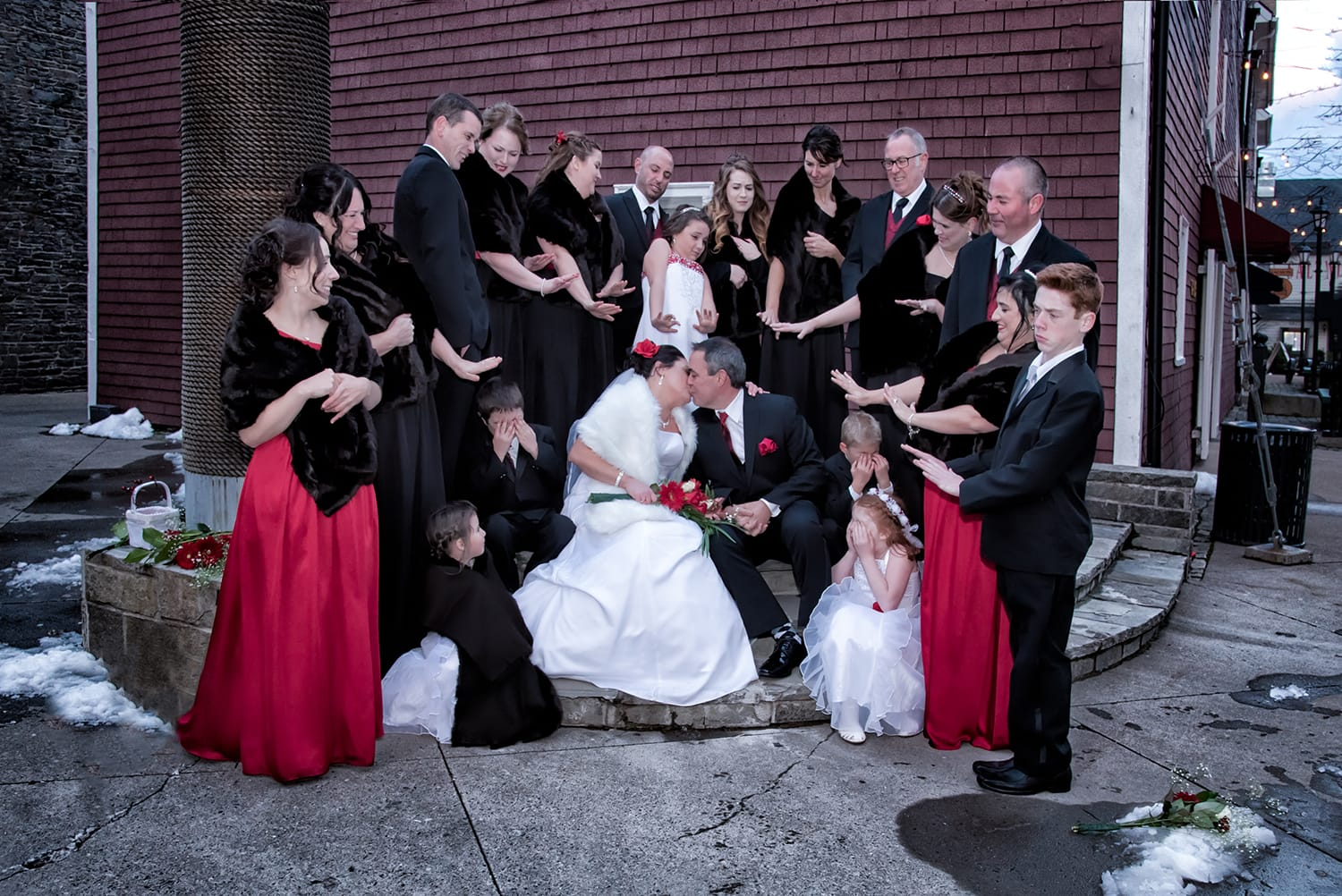 Funny wedding party photos with the bride and groom kissing at the Historic Properties captured by Halifax Nova Scotia wedding photographers Sandra Adamson Studios.
