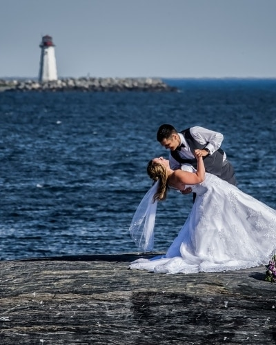 wedding photography of bride and groom at Point Pleasant Park with lighthouse in the background