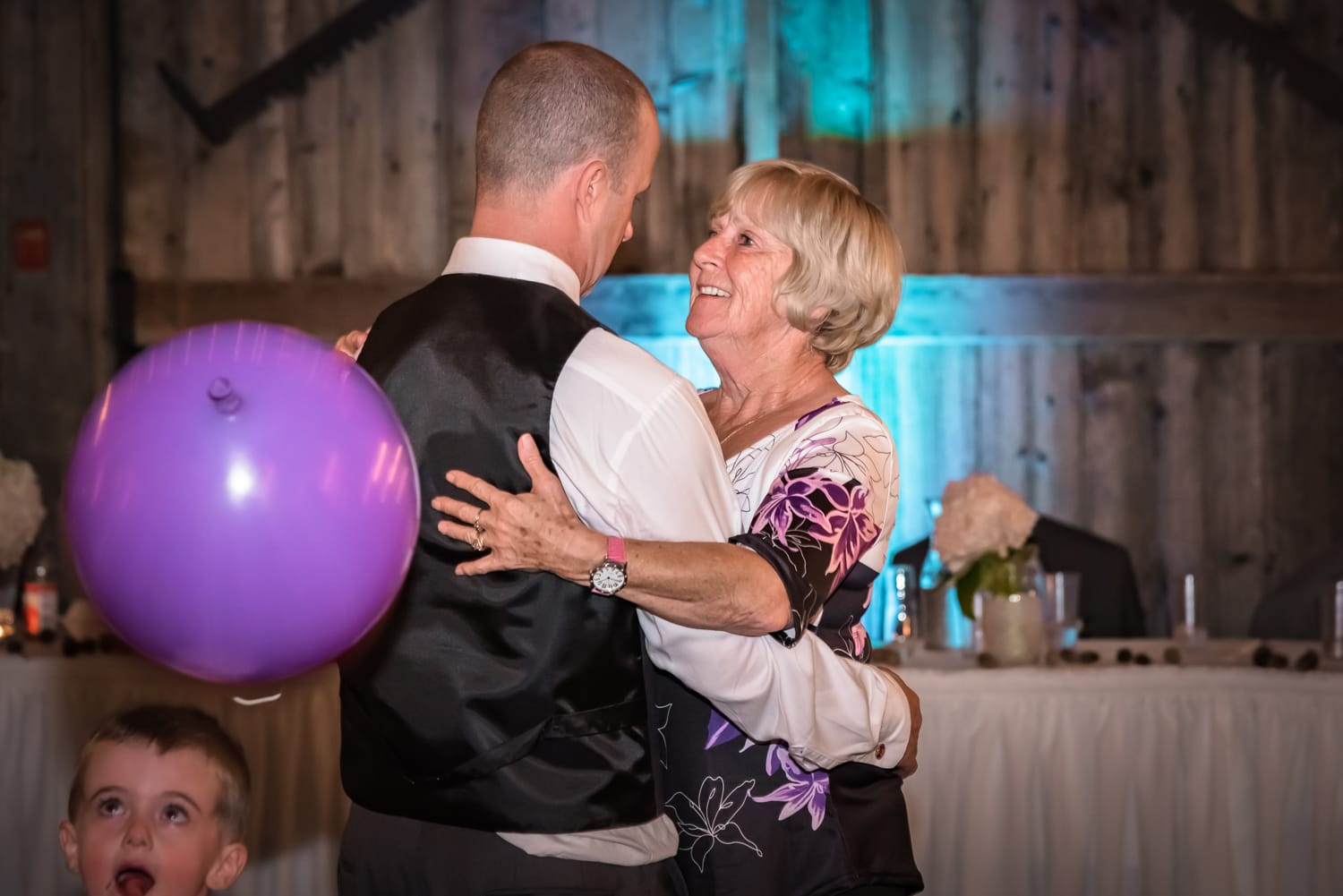 A mother dance's with her son, the groom, during his wedding at the Old Orchard Inn Heritage Barn in Wolfville NS.