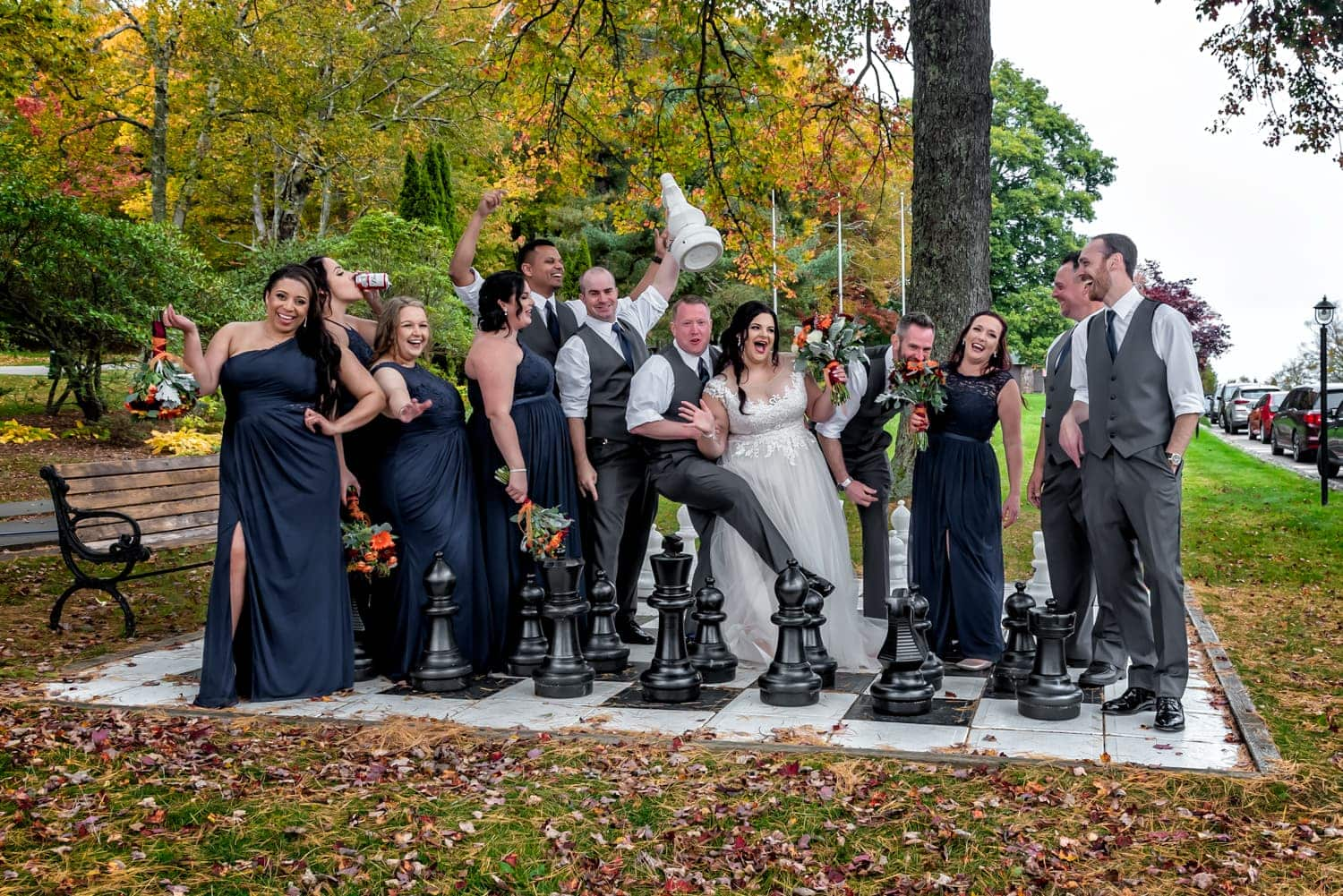 funny wedding party photos at a Digby Pines wedding with the bride and groom on a giant chessboard