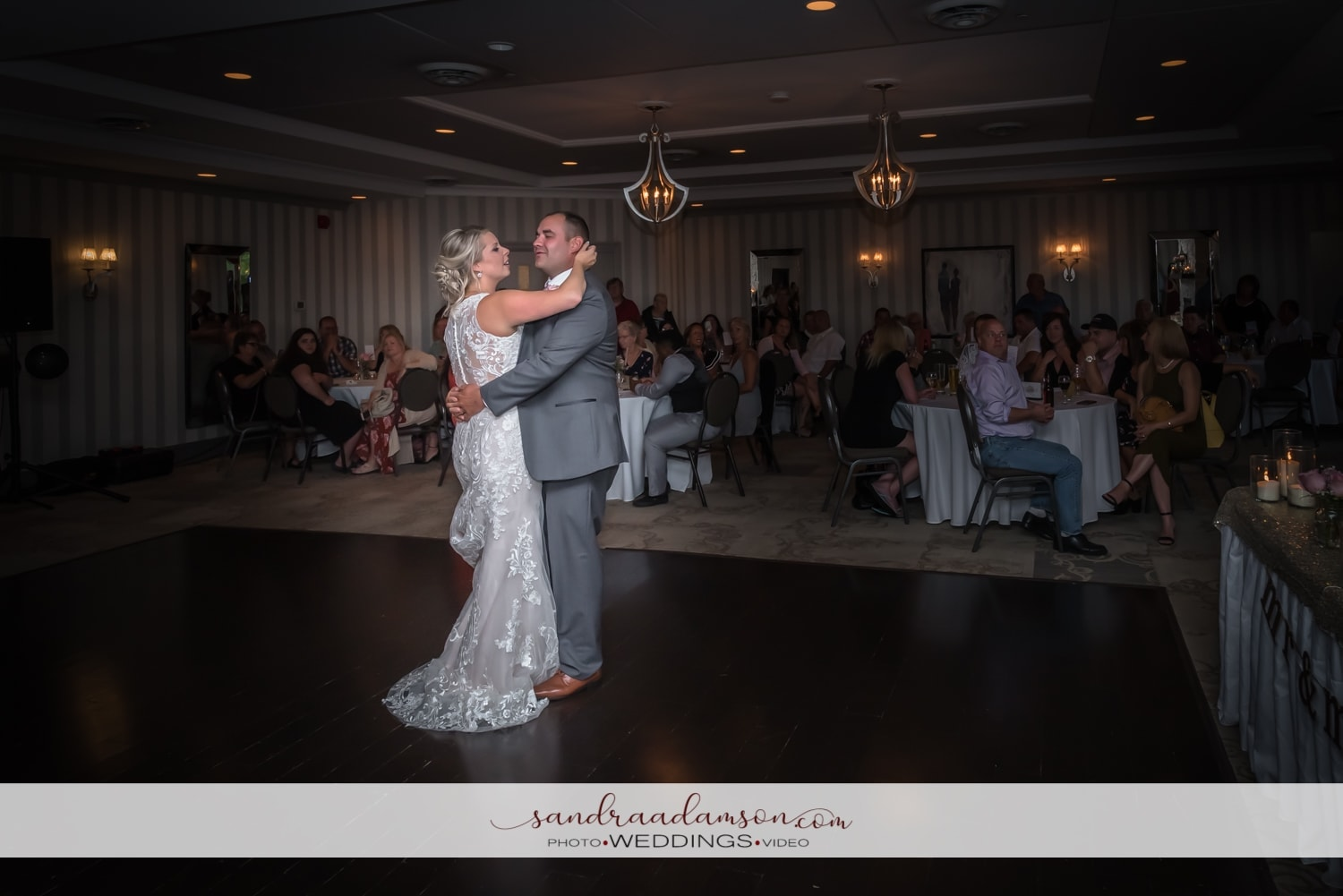 The bride and groom have their first dance together at the Ashburn Golf Club in Halifax, NS.