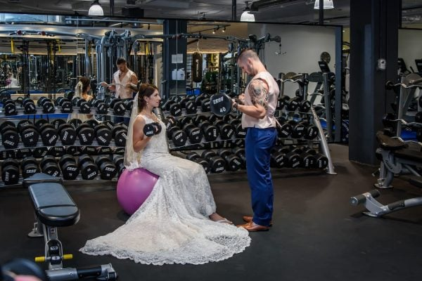 Halifax wedding photographers are with the bride and groom as they work out at the O2 Wellness gym in bedford ns.