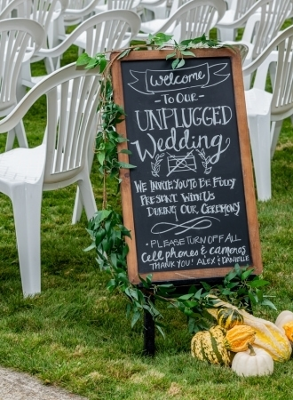 An unplugged ceremony sign welcoming the guests at the ceremony location at Digby Pines.