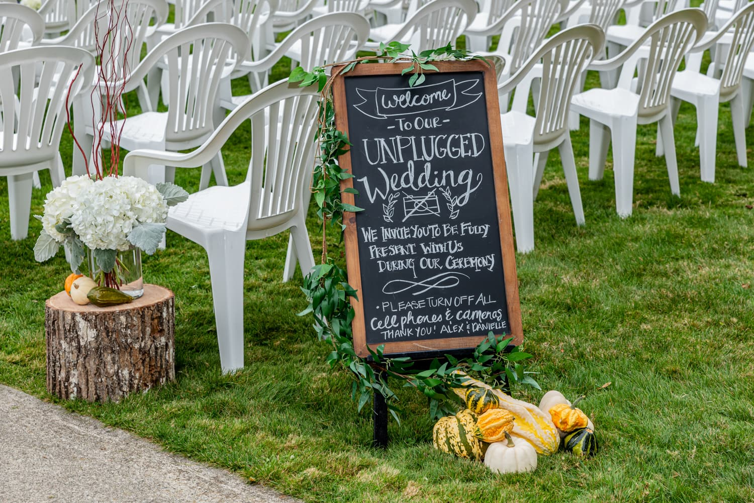An unplugged wedding ceremony sign welcoming the guests at the ceremony location at Digby Pines.