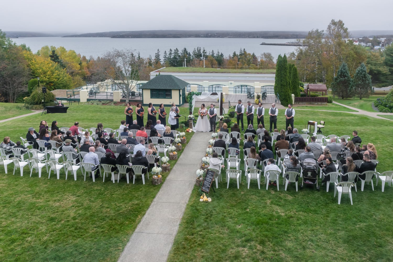 An aerial view of the bride and groom's wedding ceremony outside at Digby Pines.