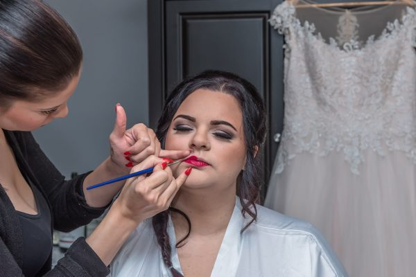 The bride getting bridal makeup applied for her Digby Pines wedding.