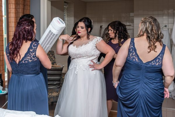 Halifax wedding photographers capture the bride and bridesmaids getting ready at Digby Pines.