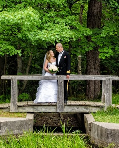 Wedding photos of bride and groom on a wooden bridge in point pleasant park Halifax.