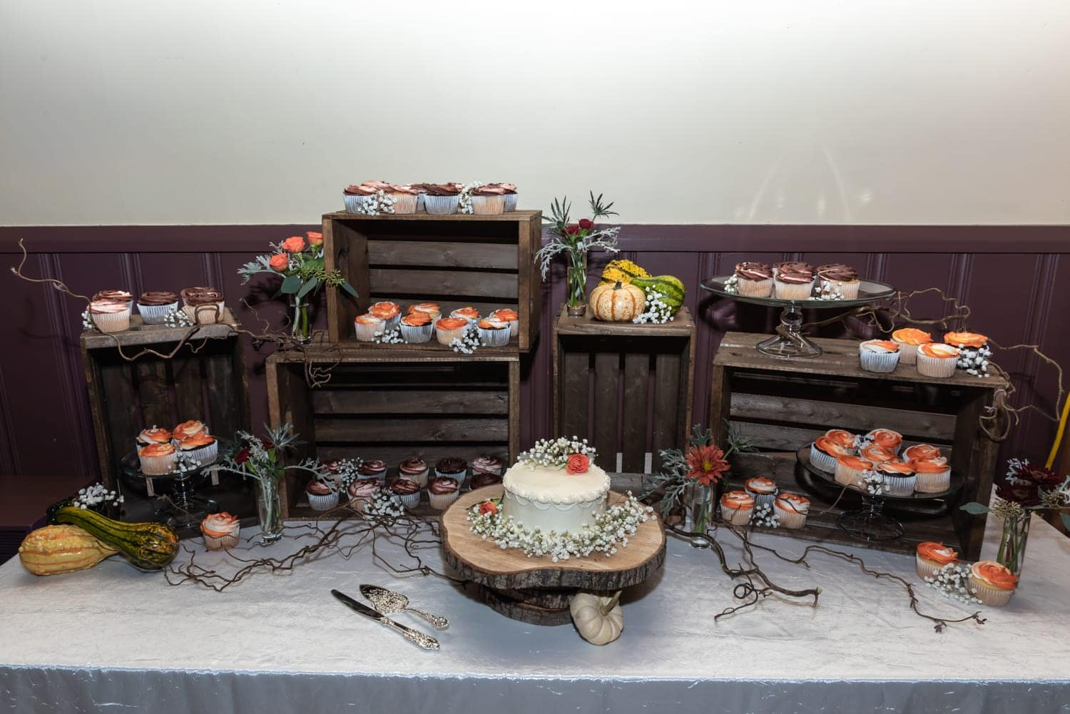 wedding cake with wedding cupcakes in a rustic wooden crate style display at Digby Pines