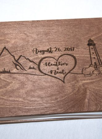 a wooden wedding guest book for guests to sign displayed at a wedding at Best Western Chocolate Lake in Halifax