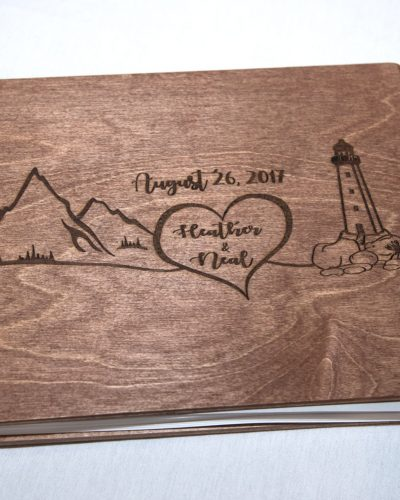 A wooden wedding guest book for guests to sign displayed at a wedding at Best Western Chocolate Lake in Halifax.