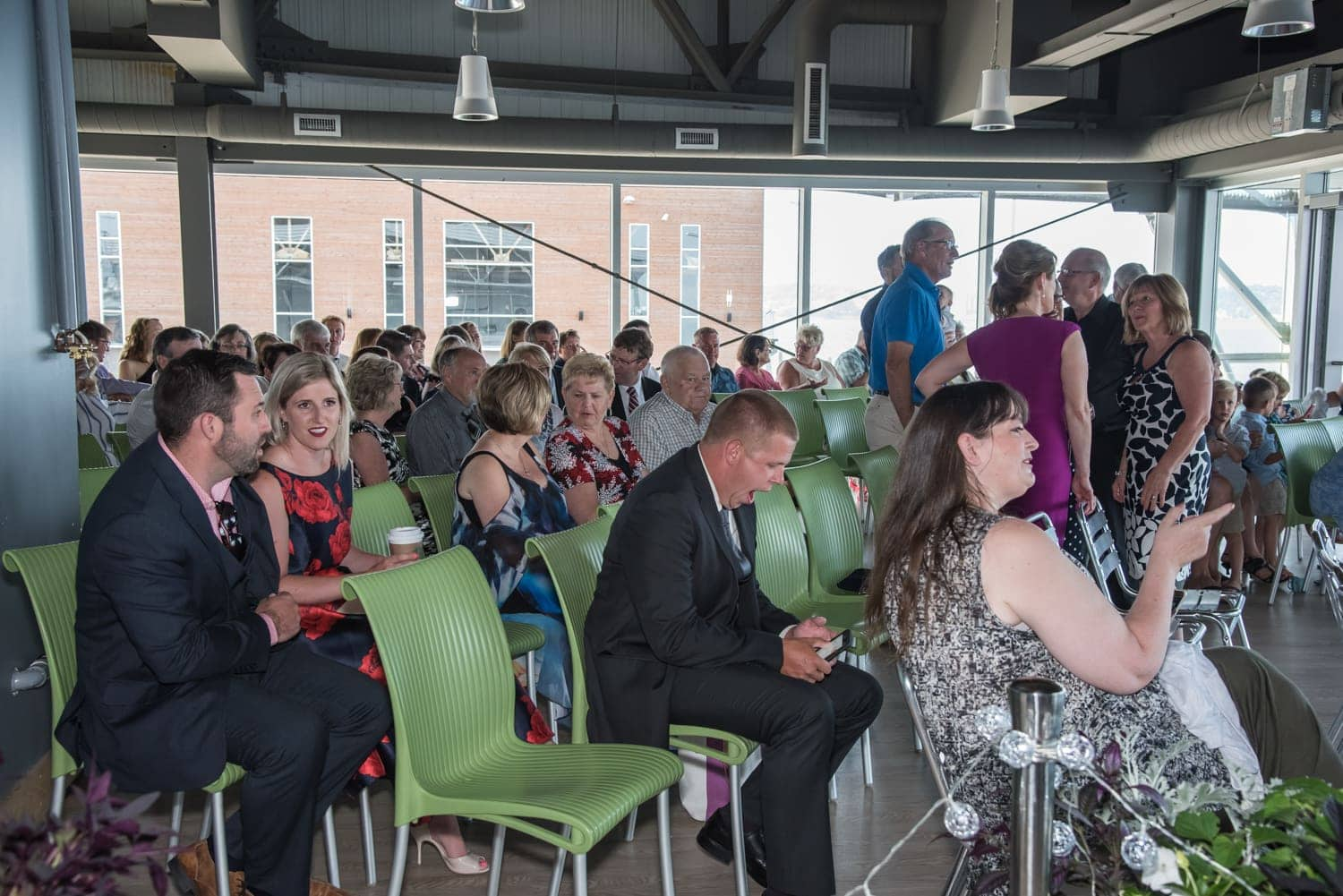 Guests at a wedding ceremony at the Halifax Seaport Farmer's Market, a farmer's market wedding venue.