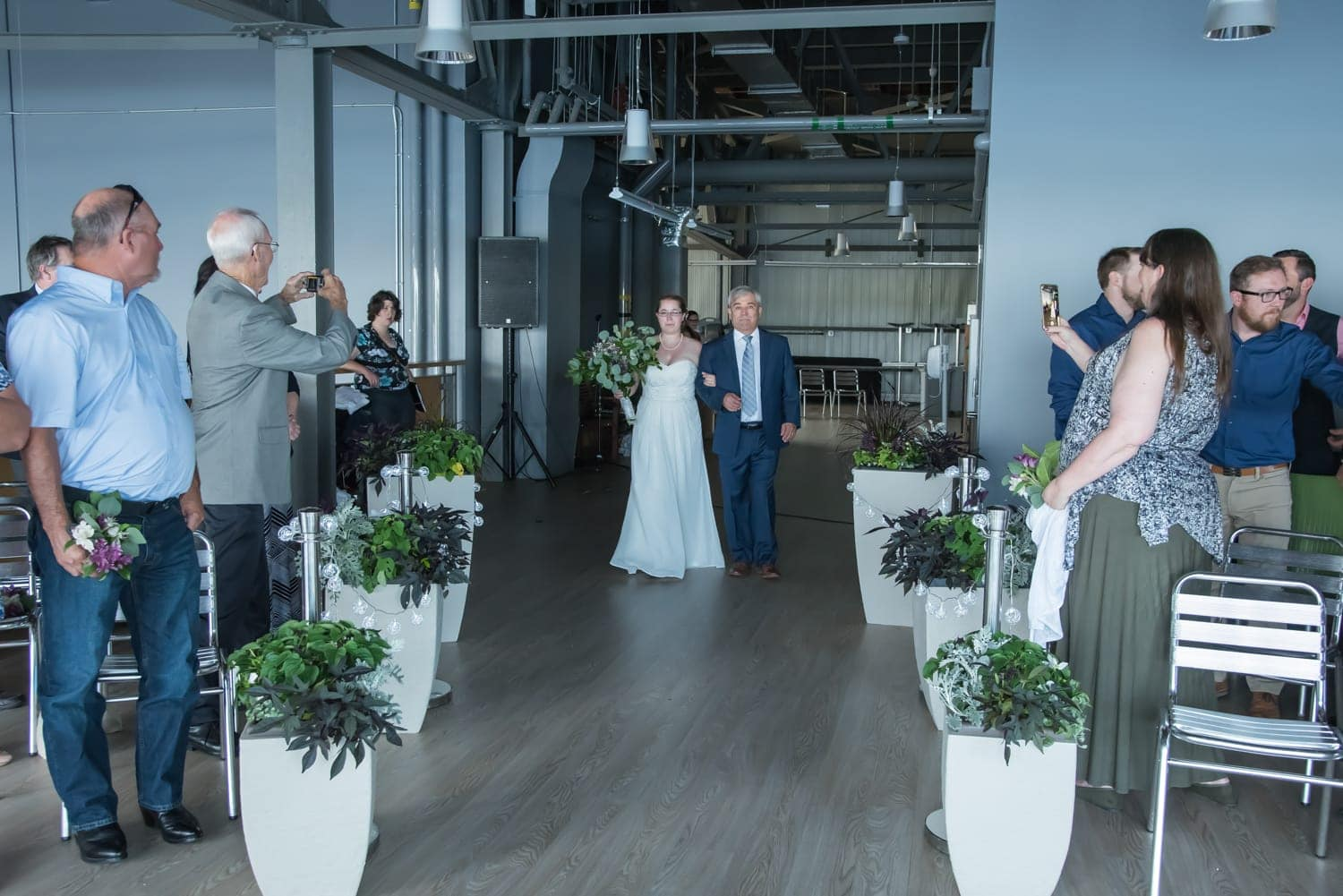 the wedding aisle with bride and father of the bride at the Halifax Seaport Farmer's Market
