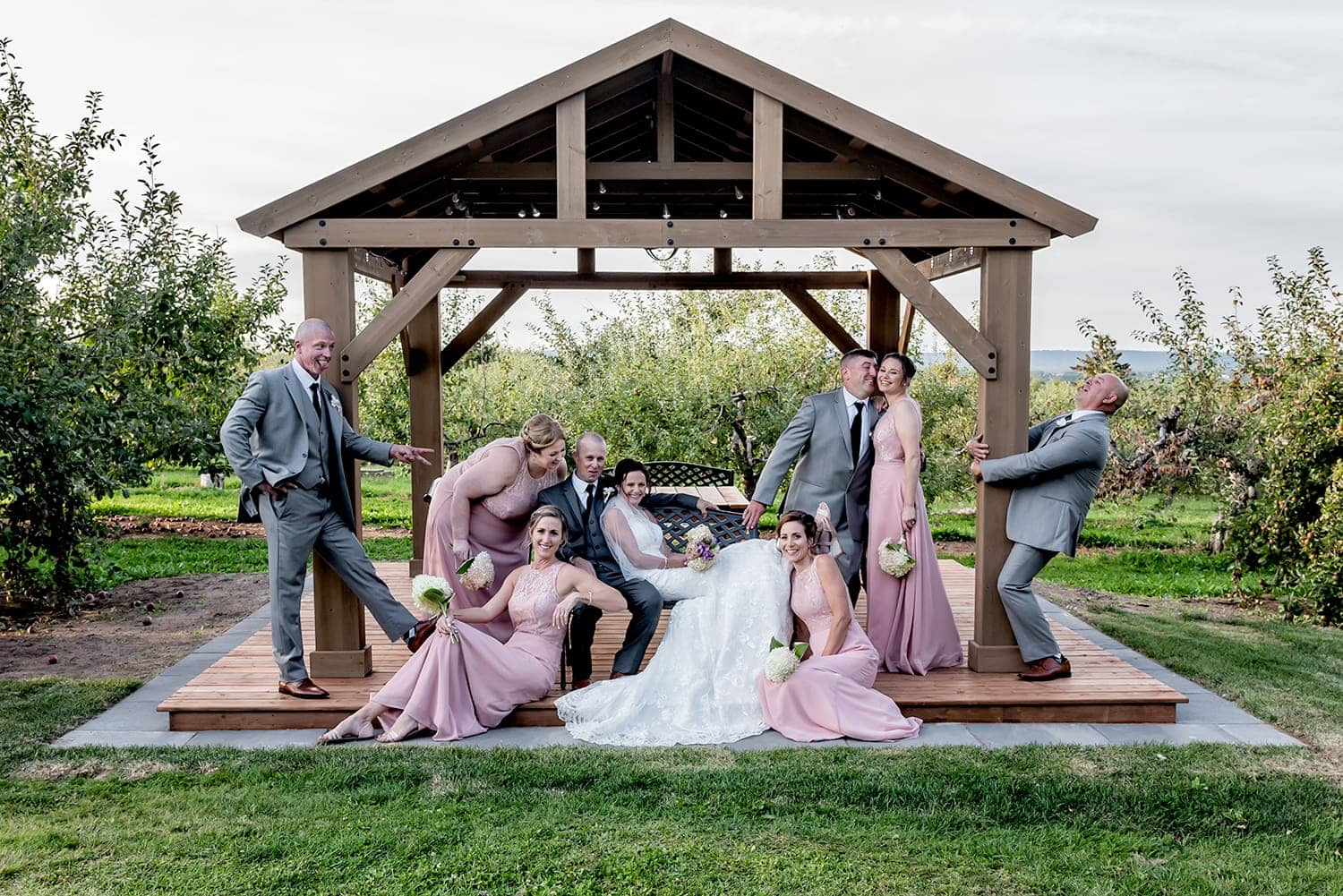 The wedding party photos with the bride and groom under a trellis in Wolfville NS.