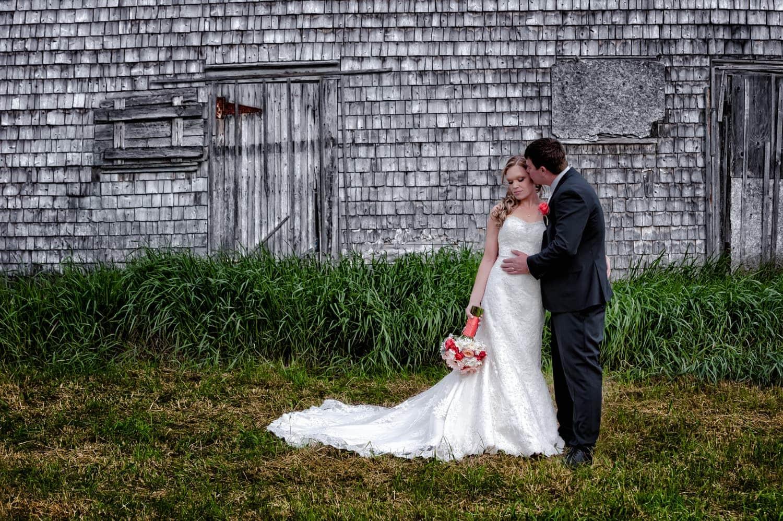 bride and groom infront of a barn in Sambro Nova Scotia