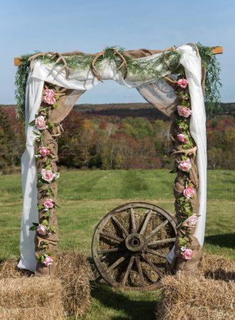 A backyard rustic wedding arch.