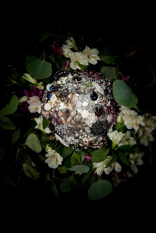 A huge DIY wedding bridal brooch bouquet.