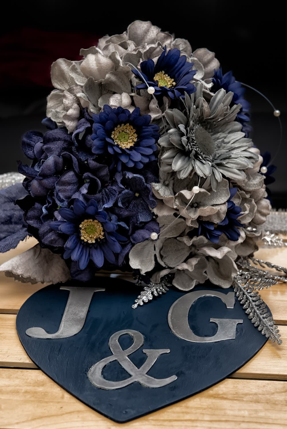 A silk faux flower bridal bouquet in navy and grey.