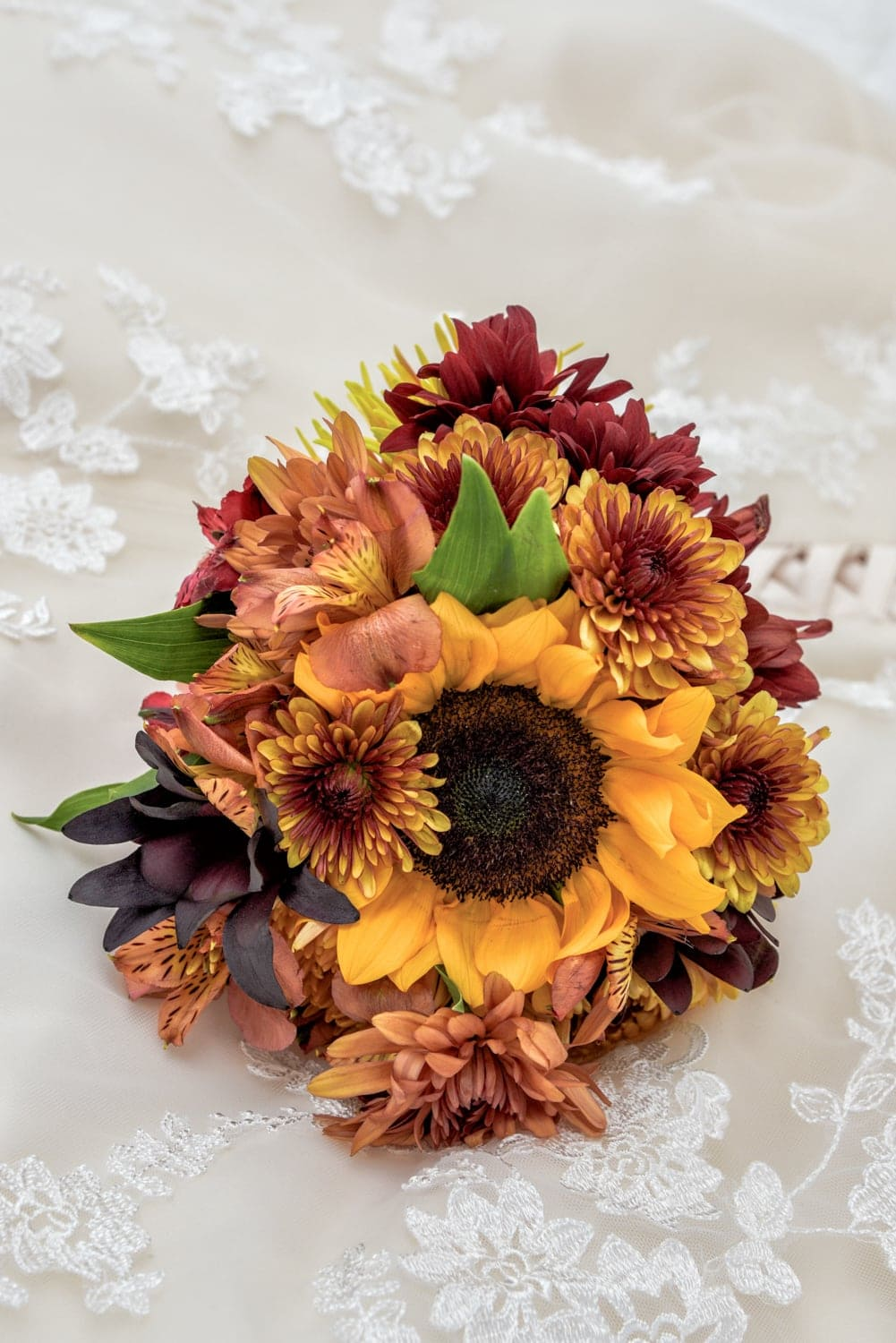 A beautiful sunflower wedding bridal bouquet with brown accents.