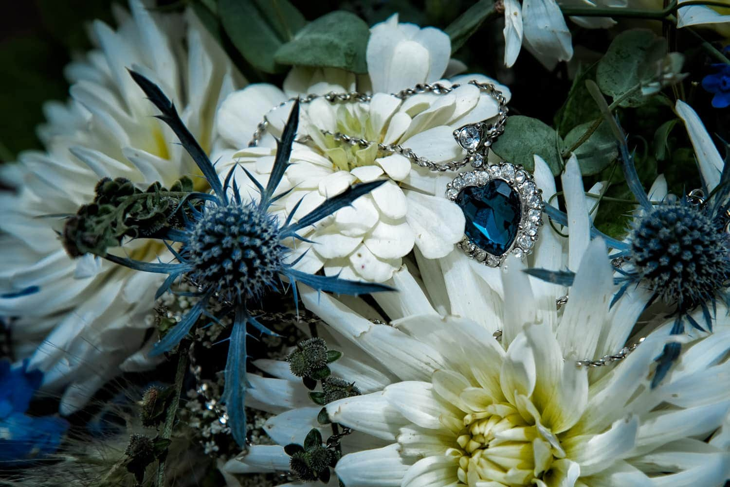A beautiful wild flower style navy and ivory wedding bridal bouquet.