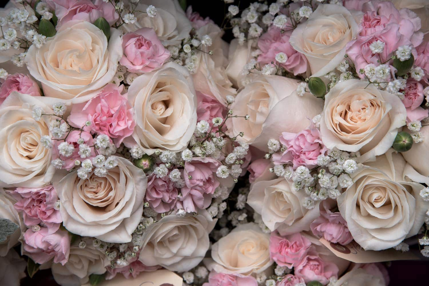 A wedding bridal bouquet of ivory and pale pink roses.