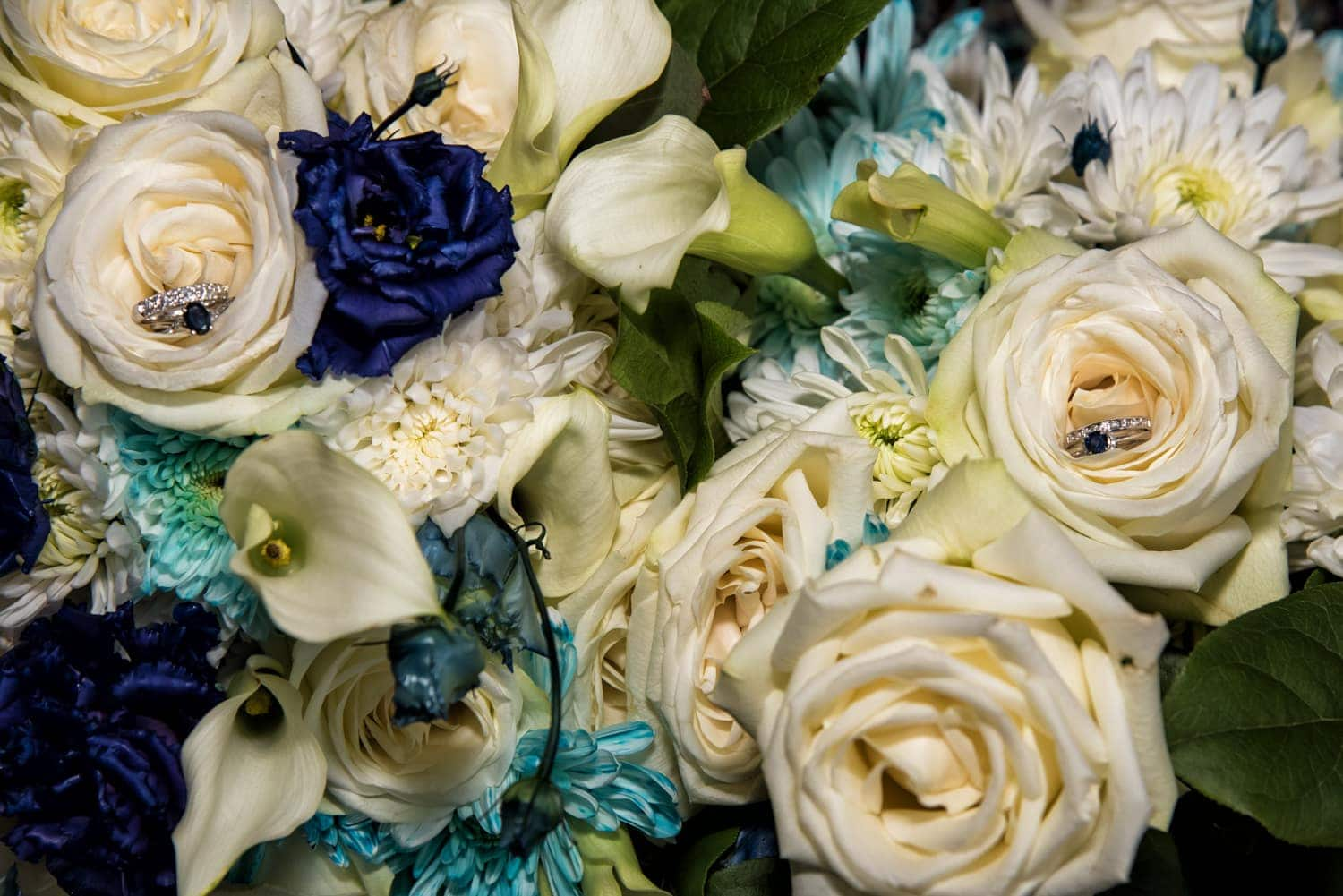 A wedding bridal bouquet of ivory and navy roses and flowers.