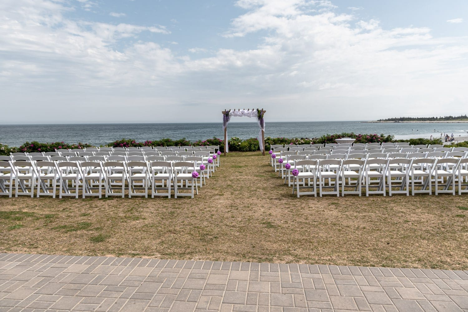 The wedding ceremony set up for a White Point wedding for a nova scotia wedding venue.