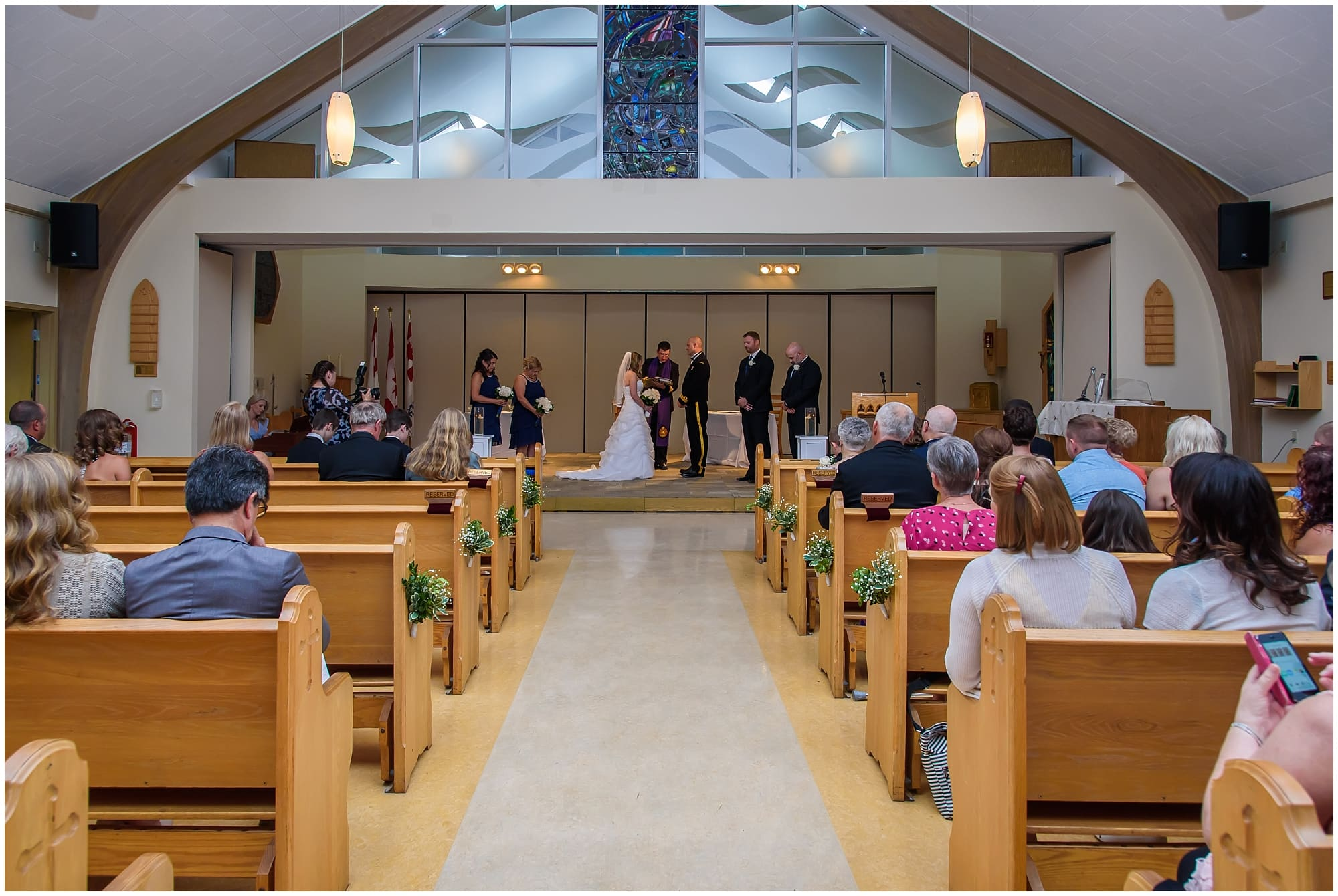 A wedding ceremony at St Brendan's Chapel by Juno Tower in Halifax, NS.