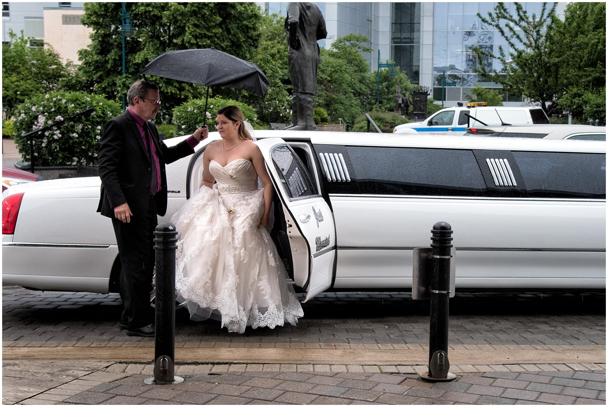 The bride getting out of a limo for her wedding photos at the farmer's market in Halifax.
