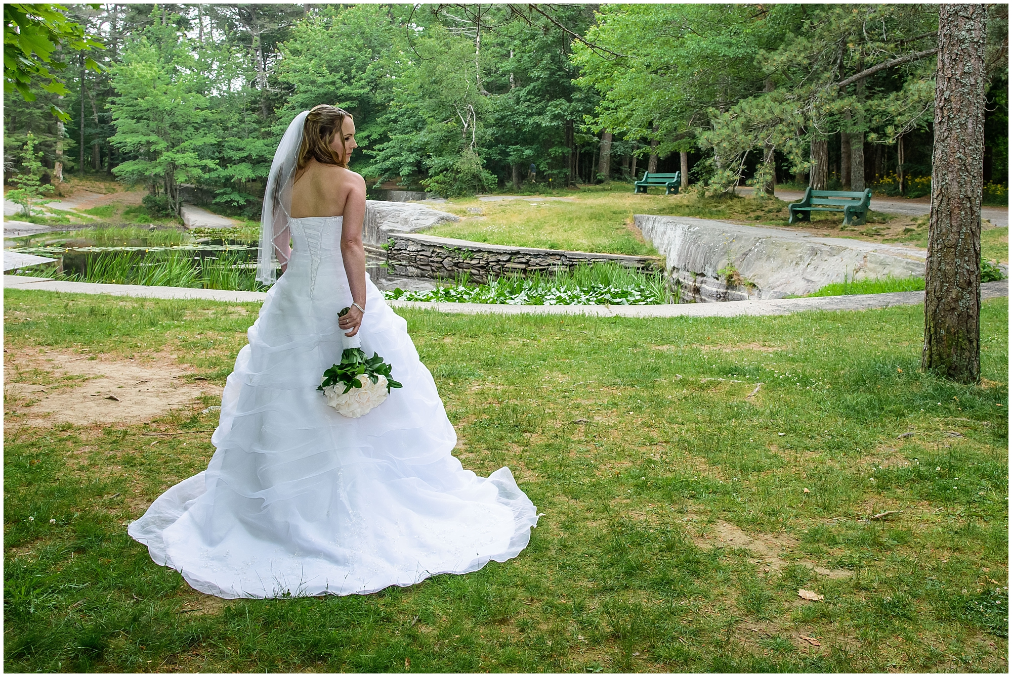 The bride posing for her wedding photos at Point Pleasant Park in Halifax, NS.