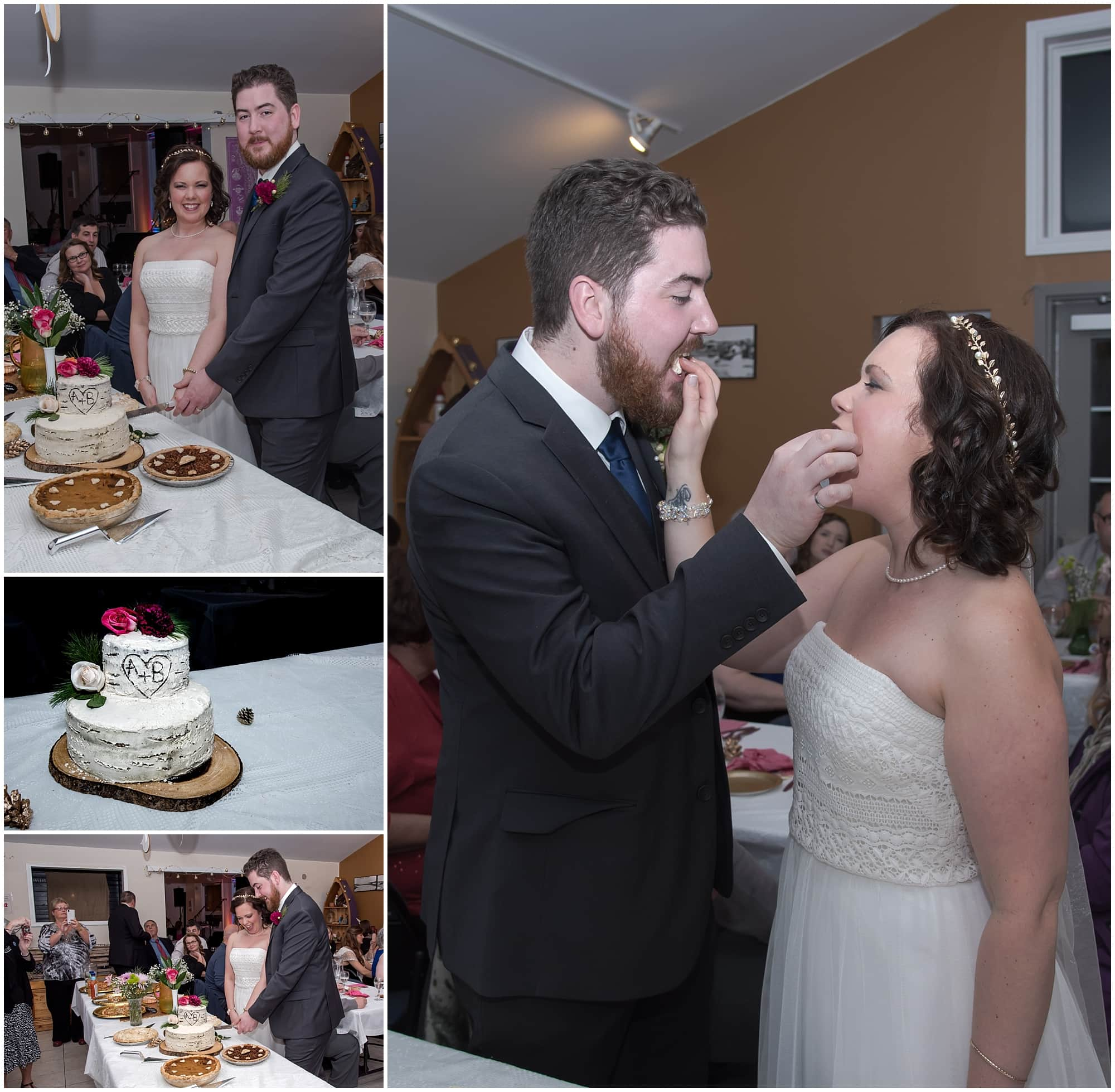 The bride and groom cut the wedding cake and feed each other during their wedding at Fisherman's Cove Heritage Center in eastern Passage NS.