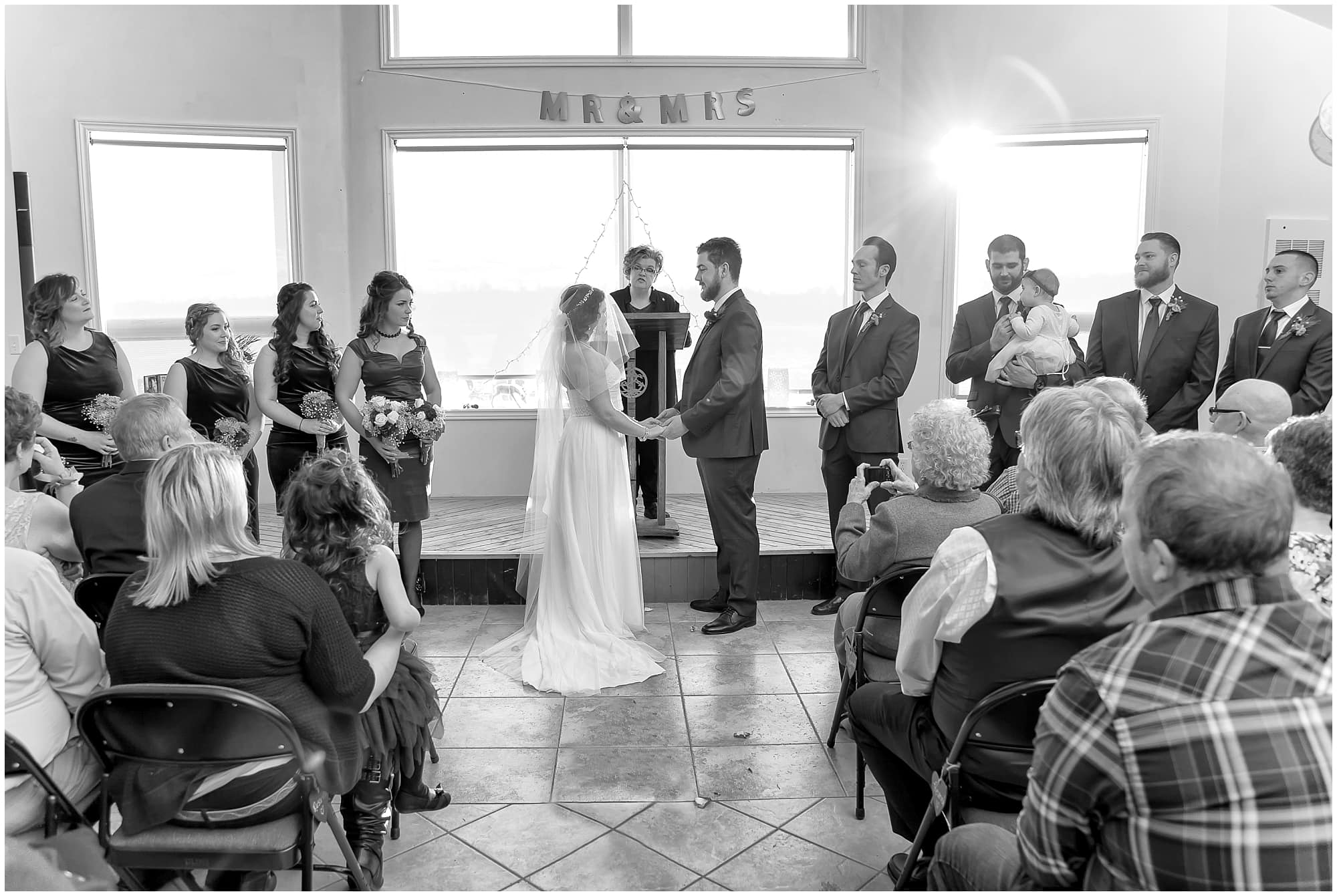 The bride and groom during their wedding ceremony at Fisherman's Cove in Eastern Passage NS.