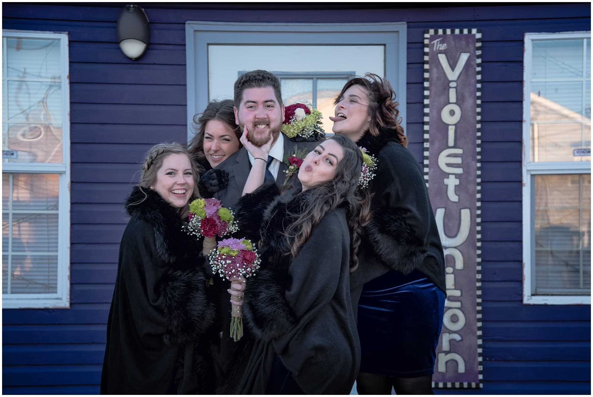 The groom with bridesmaids posing for funny wedding party photos at Fisherman's Cove in Eastern Passage, NS.