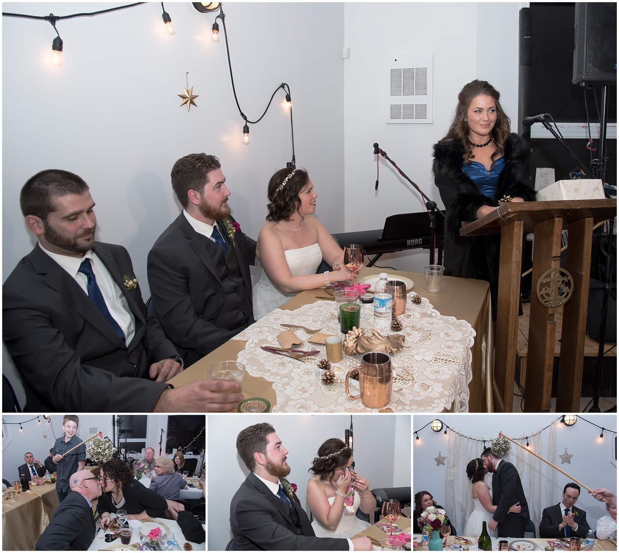 The bride and groom during their wedding reception, kissing under the mistletoe during their winter wedding at Fisherman's Cove in Eastern Passage.
