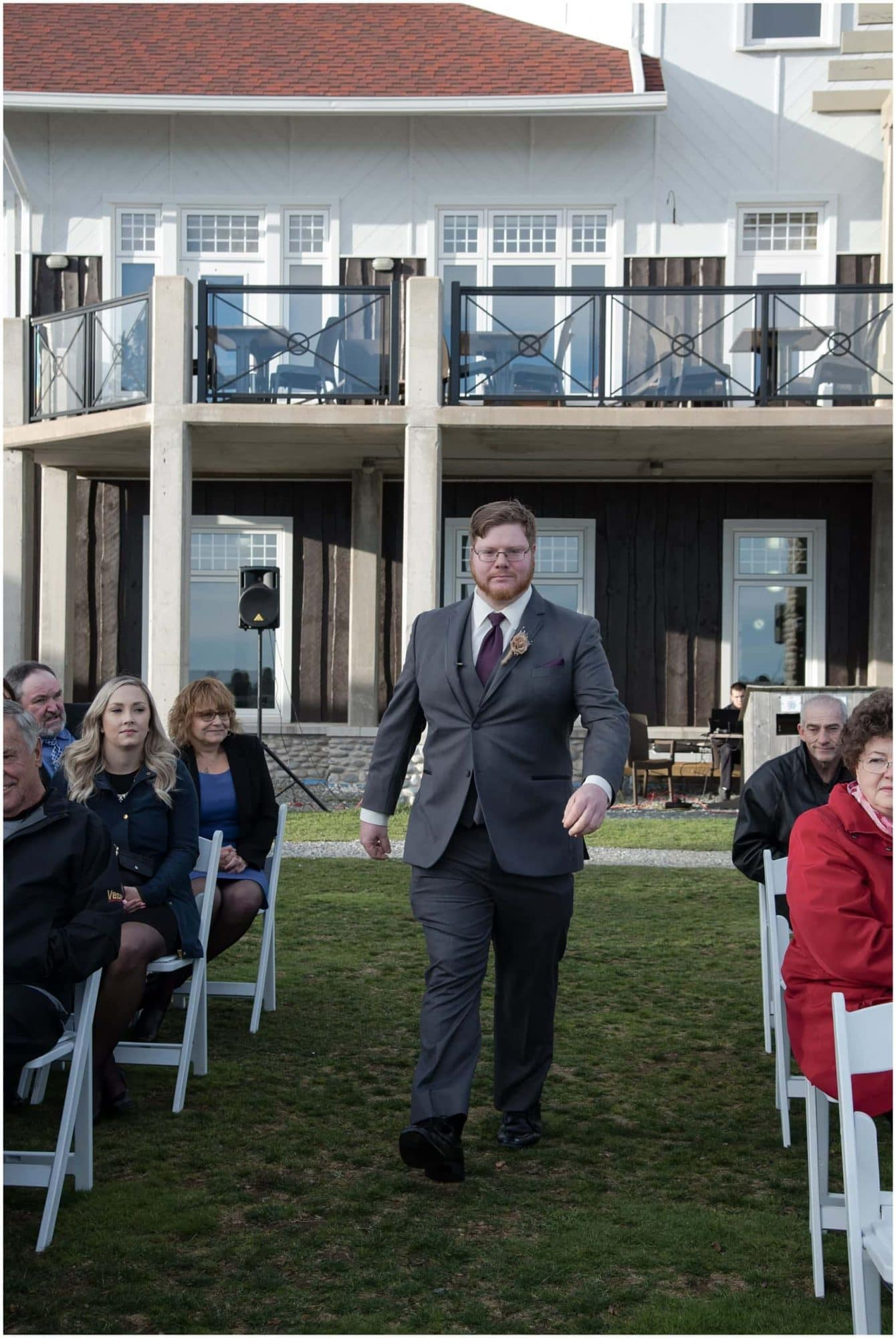The groom walks up the aisle to the alter for his wedding ceremony at White Point Beach Resort in NS.